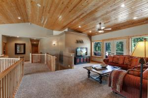 Stunning tongue and groove ceilings, wood banister balcony, Hampton Bay ceiling fan