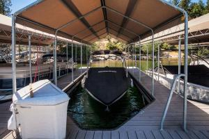 Gated dock access, Fourth slip from ramp, 12' wide x 22' deep, community beach with picnic area