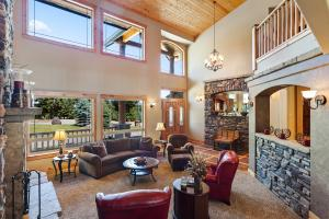 Natural light pours in through the two story vaulted room