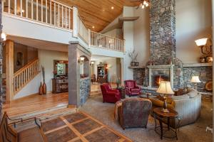 Floor to ceiling stacked stone wood burning fireplace