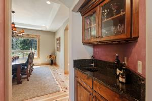 Conveniently located between the gourmet kitchen and formal dining room