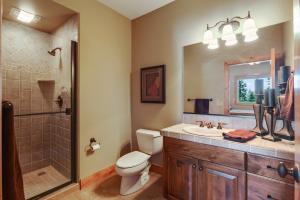 Step in tiled shower, tiled vanity with Knotty Alder cabinetry