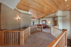 Master suite and loft are separated by railed catwalk from the 3rd/4th bedrooms and bonus room