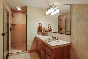 Bathroom near bonus room with adjacent laundry closet