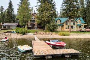 Upper Twin Lakes beautiful Craftsman with 51' of frontage and over 2700 SF, level sandy beach and private dock.
