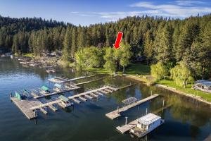 Great location adjacent to a private park for 22 homeowners with a community dock. No side house, just open and full of nature and more waterfront!