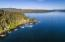 Prime Rockford Bay location. Rare level lawn to waters edge and a sandy beach!