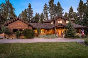 In the famed Hayden Lake Country Club area sits this stunning log and beam home with a wrap around porch and tranquil setting...
