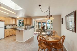 Lovely kitchen and breakfast nook that opens to living/dining room.