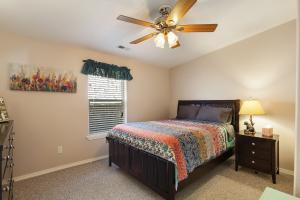 Another lovely bedroom with ceiling fan