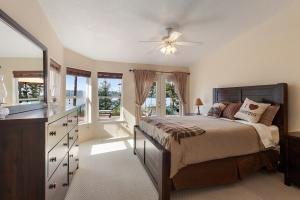 Large bright master bedroom with french doors to deck.