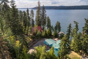 Nestled in the trees, this home offers privacy and spectacular lake frontage