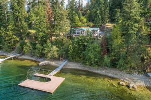 Home is nestled in the trees not far from the sandy shoreline and nice covered boat dock