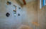 With sleek Travertine tile and dual showers