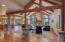 Open feel with abundant natural light, vaulted ceilings w/beam accents and antler chandelier, perfect for gatherings