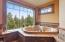 Raised Kohler jacuzzi tub w/incredible window views & tile surround - relax away