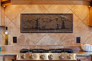 Custom tile above cooktop
