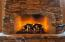 Eldorado stone, wood mantels, gas fireplace with arches that are custom