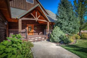 Timber frame accents. Trex type decking and warm wood touches adds to the warm and welcome of this home.