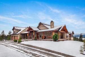 2013 Parade of Homes Winner! Main floor easy living with an open floorplan, abundant natural light, a peak of the lake, bonus room, room for a shop, 3 car garage and RV Parking! Wow.