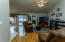 Directly adjacent to kitchen - glass doors lead to backyard and outdoor kitchen!