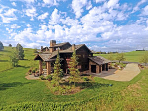 Expansive views of the surrounding mountains and meadows.
