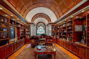 The signature black walnut barrel ceiling library is a one of a kind design. Just off the great room with stained glass accents from 1887, beautiful hardwood floor, & under cabinet mood lighting...this will quickly become one of your favorite rooms