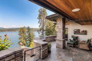 Enjoy the beauty indoors and out on the comfortable covered patio- the lake calls you!