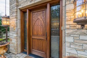 Outside doors with triple locks, custom carved, Colorado Stone and Stucco welcome you - welcoming and inviting.