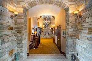 Stacked stone exterior & interior entryway; Skylights, arched curves, wide halls and the Wow 4 sided fireplace greets you!