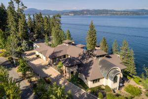 Corner double WATERFRONT lot at end of cul-de-sac - quiet and private (lot to South also included with swimming beach)! Gated community (two gates enclave of special homes), 291 Feet of prime deep waterfront, your own dock and tram. Only 20 minutes to downtown Coeur d Alene (5 min by boat!). This is rare and special.