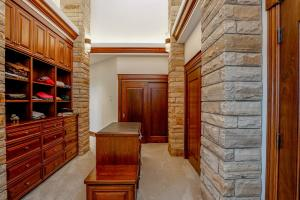 Huge dressing area w/shoe area and built-in drawers, shelves, hamper & stool - this is incredible!