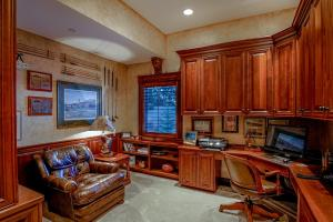This tucked away private office is just off the master in its own room w/ lake views & built-ins...some days you just have to do a little work - it might as well be here!