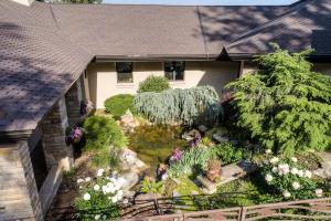 Peaceful oasis with lush landscaped design and water feature- tranquil, beautiful, mesmerizing