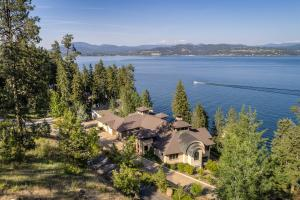 Enjoy the mountain and lake living lifestyle in North Idaho- only 5 minutes by boat the the Coeur d Alene Resort and Gozzer