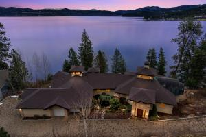 This is the most outstanding location on Coeur d Alene Lake. Breathtaking in every way, from the custom designed Colorado sandstone to the 4 way two story stone fireplace, to the waterfront and views....you'll want to stay here and linger for a lifetime! Private gated Steven's Point neighborhood of multi-million dollar homes for the True Connoisseur of life.