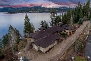 4+ car heated garage with drain bay and heated floors, built-in workbench, hot & cold water w/drain under every car. RV parking on side of home - most magical setting on the lake...