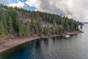 Private dock and beach on the shores of the Lake. The beachfront is yours adjacent to the HOA beach, the dock is yours, the precious moments of living this life can be all yours too!