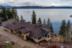 Corner double WATERFRONT lot at end of cul-de-sac - quiet and private (lot to South also included with swimming beach)! Gated community, 291 Feet of prime deep waterfront, your own dock and tram. Only 20 minutes to downtown Coeur d Alene. This is rare and special.