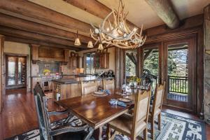 Solid mesquite dining table seating six overlooking the meadow and elk sightings!
