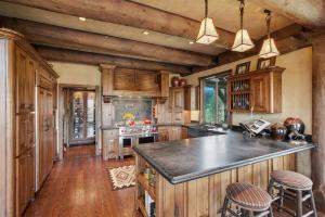 Originally designed, hand crafted Knotty Alder cabinets with Soapstone counter tops, the cuchina butler pantry is a must see