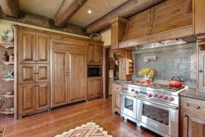 Bentwood ranger hood and custom crafted Soapstone backsplash w/pot filler. Built-in refrigerator. The chef will be delighted!