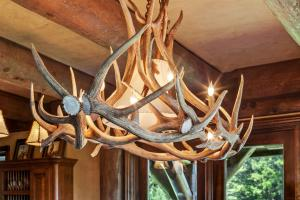 Naturally shed antlers adorn the dining space