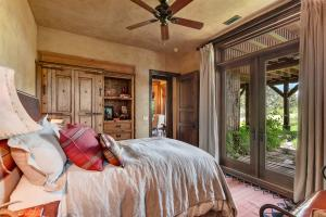 Lower level with doors to patio and custom built in furniture