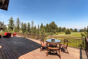 Huge 3000 SF Entertaining Deck with views of the mountains and pastures. Hot tub hookups, your outdoor living room.