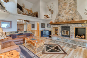 Massive floor to ceiling stone fireplace with innovative RSF ducted insert