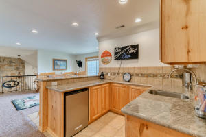 Full wet bar with granite counter top.