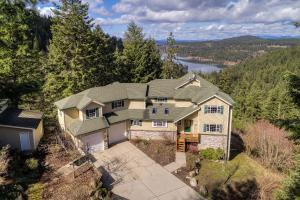 Lake Fernan views from this 10 acres, with large custom built home secluded in the trees.