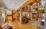 Solid wood flooring, beam trusses, Tamarack logs accent the home with warmth and beautiful living
