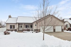 In desirable Rocking R on a light filled corner lot with a 3 car garage and lovely backyard, this is a easy open design plan.